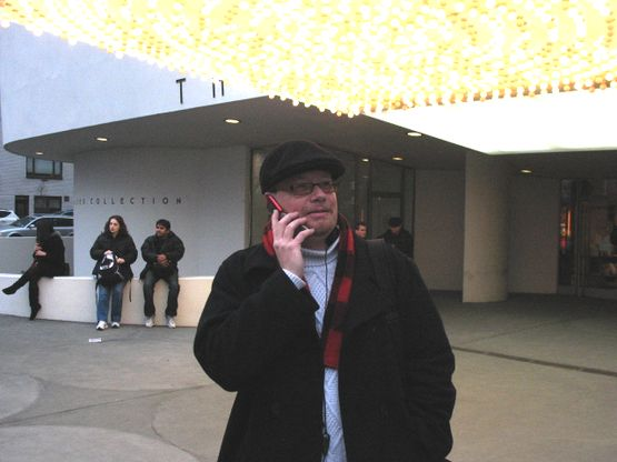 Me outside the Guggenheim Museum on cellphone with Juan