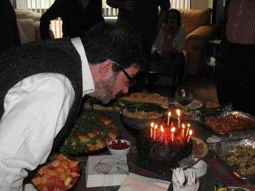 JOhn Hamilton in one of several attempts to blow out the candles on his birthday cake