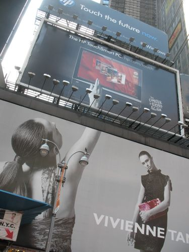 I just thought this was cool- 2 billboards connecting to each other
