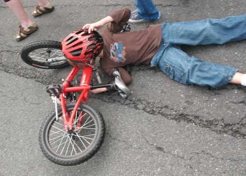 He was actually told to get off his bike by his mom and this is his dismount.  True story.