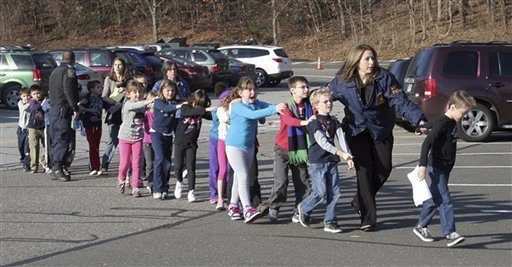 Children being evacuated from what should have been a safe space at Sandy Hook Elementary School in Newtown CT.