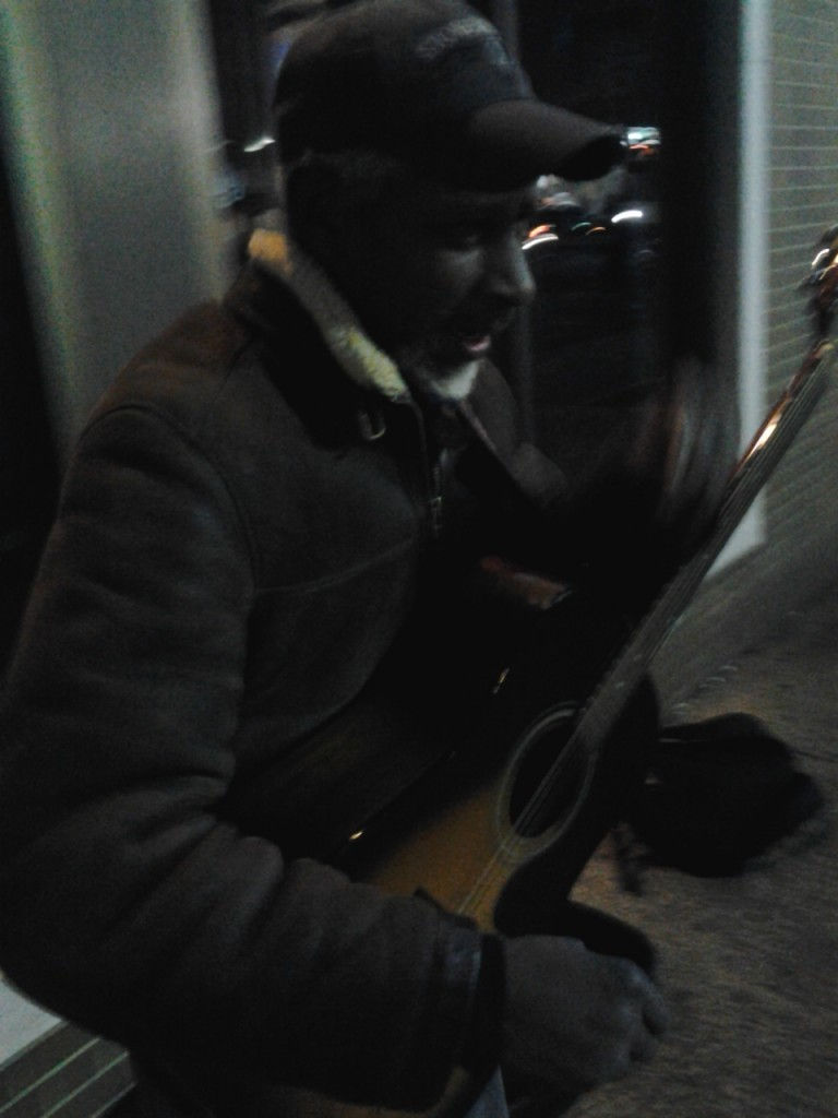 Tariq on the street busking, 32° weather, 8:30PM