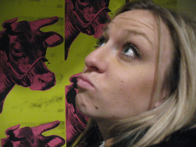 Corinne with Warhol's Cow wallpaper.